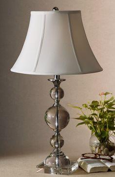 Очаровательная хрустальная настольная лампа от производителя Uttermost. Рассчитана на 100W.             Материал: Металл, Ткань, Хрусталь.              Бренд: Uttermost.              Стили: Классика и неоклассика.              Цвета: Белый, Светло-серый.