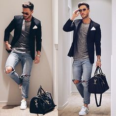 Shop this look on Lookastic: https://lookastic.com/men/looks/blazer-crew-neck-t-shirt-jeans/16933   — Black Blazer  — White Pocket Square  — Grey Crew-neck T-shirt  — Silver Watch  — Light Blue Ripped Jeans  — Black Leather Holdall  — White Low Top Sneakers