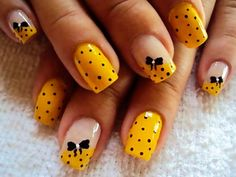 Bows black dots yellow nails. Nail art. Probably the only time I thought of wearing yellow nail paint. Cute!