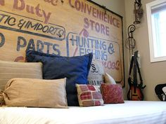 sign-headboard...This projects shows the diversity of item you can use to create an original headboard. This one is realized with a reclaimed convenience store sign that looks as good as new and a beautiful eye-catching backdrop for a daybed. The theme provided by the sign is not everything to this room but its historic significance makes its owner to almost  taste those times.{found on funkyjunkinteriors}.