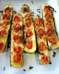 Low carb!...YES!! talk about yummy! SIMPLE & EASY...  Slice the zucchini in half. Slice off the bottom to keep in stable. Brush with olive oil and top with garlic or garlic powder. Top with sliced tomatoes, salt and pepper to taste. Use mozzarella cheese, Parmesan cheese or mixed blend.. Bake 375 for 20 to 30 minutes until soft.  Courtesy of: Nulife4u