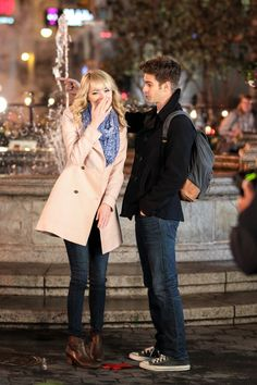 Andrew Garfield & Emma Stone on the Spider-Man 2 set looking adorable.