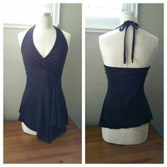 """Sexy Little Black Halter Dress Top Sexy Little Black Halter Dress Top by White House Black Market in EUC with no flaws. Very versatile can easily be dressy or casual. Measurements are: Length is 27""""-31"""", Bust width is 15"""", Empire Waist width is 13"""", waist width at the bottom bells out to 20"""". Located in Poshmark closet @taylord2covet. White House Black Market Tops"""