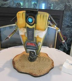 Amazing nerdy Borderlands Clap Trap cake by Mike Elder of Black Sheep Custom Geek Cakes