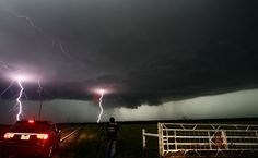 Cloud to ground lightning strikes near storm chasers during a tornadic thunderstorm in Cushing May 31, 2013. Violent thunderstorms on Friday produced tornadoes in central Oklahoma that is said to have killed nearly 13 people.