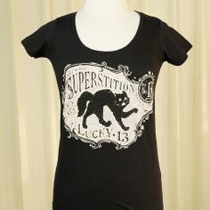 Superstition Cat Scoop T Shirt:We just can't get enough of black cats here! This is a ladies black scoop neck T shirt with a front print of a black kitty and reads Beware Superstition Black Cats Lucky 13. 100percent cotton. $26.00