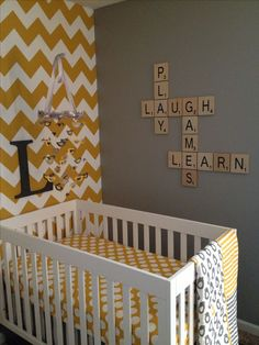 My twin's nursery - mustard chevron wall, scrabble tile letters on grey wall :)