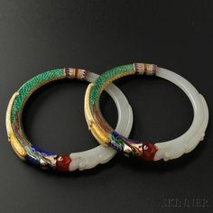 Rare pieces from the American metalsmith and jeweler Marie Zimmermann including these two beautiful bangles. The bangles join two dragons—one of carved jade and the other of polychrome enamel—with a central red bead. Jewelry Gifts, Jewelry Accessories, Jewellery, Le Jade, Antique Jewelry, Vintage Jewelry, Bangle Bracelets, Bangles, Jade Jewelry
