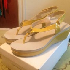 Calvin Klein Wyomi Two Tone Patent Yellow Sandals Brand new platform sandals. Heel 2.5 inches. Platform 1.25 inches. NEVER WORN. Comes with box. Calvin Klein Shoes Sandals