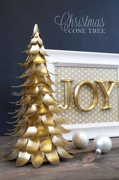 Chipboard sheets cut into leaf shapes, curled slightly, glue on cone, spray gold and you have a Christmas tree!