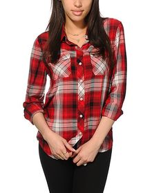 This button up shirt is crafted with an oversized boyfriend fit and an ultra lightweight and soft-feel rayon material covered in a red plaid print for the perfect blend of comfort and style.