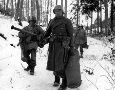 Battle of the Bulge, fighting the cold as well as the enemy.