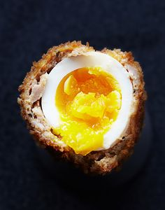 Scotch Eggs -Perfect make ahead, on the go breakfast -soft boiled egg wrapped in sausage, rolled in bread crumbs and baked or fried...mmmm