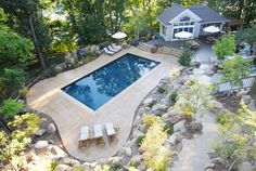 Images of pools by Pool Tech Midwest, Iowa's premier pool builder I like the free form deck around the rectangle, is this colored concrete?