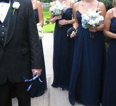 navy blue http://www.wedding-halls.net/2011/06/24/navy-blue-bridesmaid-dresses/