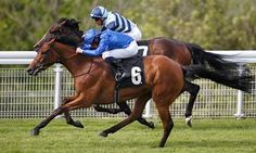 William Buick and Skiffle, nearside, catch The Black Princess to win the Height of Fashion Stakes at Goodwood on Thursday.