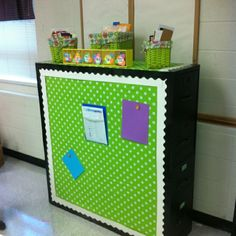 Two filing cabinets back to back with fabric to cover. Magnet board!!! Plus use CD storage pages for bulletin board letters