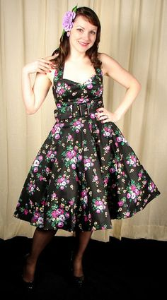Black May Day Swing Dress:Looking at this dress just brightens my day. The fabric is black with purple, white and yellow flowers throughout. The bust is lined in black and features a gathered sweetheart neckline and halter straps. It has a wide matching cloth belt that's removeable and a back center zipper. The skirt is a full circle skirt that would look great with...