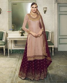 Pink Wine Embroidered Satin Silk & Jacquard Silk Sharara Designer Suit (Semi-Stitched) - #shararadesigns - Product ID: 7410-RBQ13968 Productis delivered Semi-Stitched (Unstitched) It can be custom-stitched upto bust Size 42 inches Work Type: Zari,Resham Embroidery, Cording, Sequins & Stones Work Top Color:            Pink Bottom Color:         Wine Dupatta Color:         Wine Fabric of Top:          SatinSilk Bottom Fabric:        … Long Choli Lehenga, Lehenga Suit, Lehenga Style, Party Wear Lehenga, Silk Lehenga, Sharara Designs, Lehenga Designs, Maya Ali, Chiffon Maxi