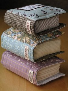 Quilted Book Plushies - Aren't these amazing? Patchwork Pottery makes these delightful book plushies, which can be used as decorations, pin cushions or even pillows for larger ones. Fabric Crafts, Sewing Crafts, Sewing Projects, Craft Projects, Pillow Crafts, Book Pillow, Pillow Talk, Little Books, Pin Cushions