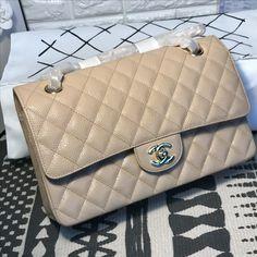 Chanel woman classic flap bag caviar beige original leather version