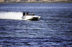 """CURRENT OWNER SAYS - """"REALLY FAST @ 125 MPH"""" """"SMOOTH RIDE"""" & ONLY 12 HOURS ON THE MERCURY OUTBOARDS....!!!!!"""