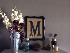 Initial M, DIY burlap. Ornate black frame! This is how I decorate my IKEA shoe holder. Mason jar, bird, jar, and left over wedding florals. Image by © KIM ALEXIS STUDIOS, LLC Www.kimalexisstudios.com