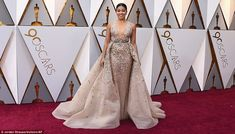Star power: Jane The Virgin actressGina Rodriguez chose a low-cut tan and silver number f...