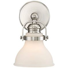 You can mount the glass up or down on this satin nickel wall sconce to suit your lighting needs.
