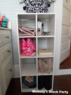 A ClosetMaid Cubeical adds storage to this bathroom.