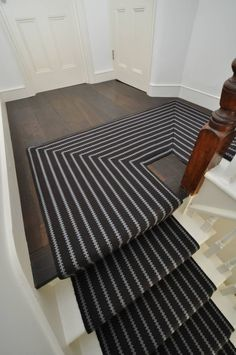 Choosing Stair Runner : Awesome Half Landing Stair Design With Dark Hardwood Floor Combine With Mahogany Newel Post And White Treads Also Black White Stair Runner