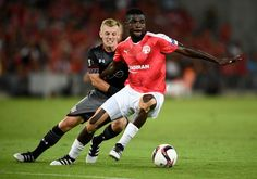 Lucio Maranhao of Hapoel Beer Sheva in action with James Ward-Prowse of Southampton in a 0-0 draw in the Europa League