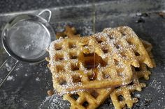 raised waffles [1/2 cup warm water 1 packet active dry yeast 2 cups milk 1 stick unsalted butter 1 tsp salt 1 tsp sugar 2 cups all-purpose flour 2 large eggs 1/4 tsp baking soda]