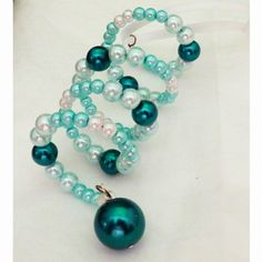 """Holiday tree ornament spiral of aqua pearls by RKBeadCreations. Holiday tree ornament, spiral of 4/6/8mm light to dark aqua pearls ending with a 14mm dark aqua pearl. This 4"""" ornament is made with memory wire, a sterling silver pin and hangs from a satin ribbon."""