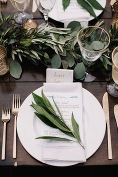 chic elegant white and green wedding table settings with a touch of gold