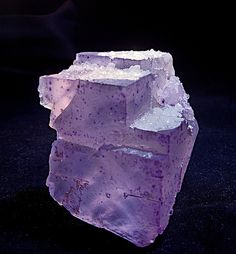 Fluorite from China -  A gemmy Fluorite crystal with sparkling Calcite crystals covering the top, from China, 3.5""