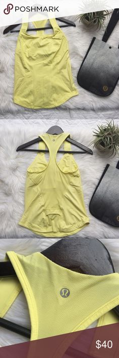 •Lululemon Yellow Racerback Tank Top• Lululemon yellow racerback tank (I'm not familiar with the name). Features built in bra. Pocket is located on the back bottom center of shirt.  Only worn a couple of items, excellent condition.   •size: 6 •color: yellow •built in bra (padding not included)  •no trades(comments will be politely ignored) •15% off 2+ items 💕 lululemon athletica Tops Tank Tops