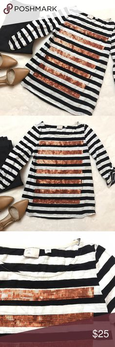 """HPANTHROPOLOGIE Sequin Stripe Tee Shirt ANTHROPOLOGIE Sequin Stripe Tee Shirt by Postmark, size XS. Roll tab sleeves, black and white striped with copper Sequin overlay. Perfect casual piece! Bust measures 32"""" and length is 22.5"""". Cotton/polyester. Anthropologie Tops Tees - Long Sleeve"""