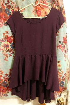 SOLD. Dorothy Perkins plum peplum high-low top w/ cutout back, UK 12/US 8 (M). Super flowy and gorgeous, but a little too big on me. Swap or 12 shipped. (See other image for back)