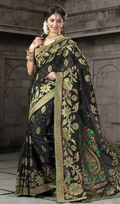 Transform your onlookers into admirers with this black color block printed cotton sari. The pretty block print work throughout the attire is awe-inspiring. Upon request we can make round front/back neck and short 6 inches sleeves regular saree blouse also. #latestprintedsaree #blackblockprintsari #womensarees