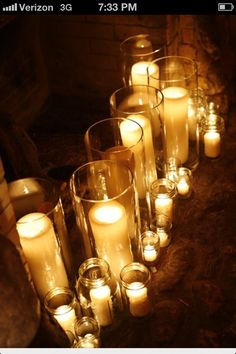 Candles in the fireplace... And yet another use for those mason jars. When it's not being used.