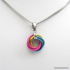 Pansexual pride pendant necklace, chainmail love knot, pan pride... ($10) ❤ liked on Polyvore featuring jewelry, necklaces, chain mail necklace, love knot pendant necklace, chainmail jewelry, pendant necklace and yellow pendant necklace