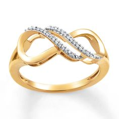 Loops of 10K yellow gold are adorned with rows of twinkling diamonds in this enthralling ring for her. The ring totals 1/20 carat in diamond weight. Diamond Total Carat Weight may range from .04 - .06 carats.