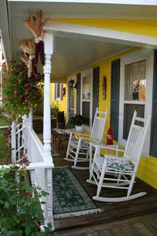 ...This porch looks so relaxing. Just to rock away the day.