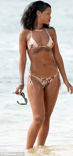 Rihanna takes part in yet another watery photo shoot in white bikini | Mail Online