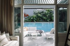 A serene view out from the living area to the outdoor pool.