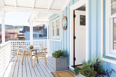 Turquoise Cottage exterior with porch. Nest Design Co. Nest Design, House Design, Sausalito Houseboat, Turquoise Cottage, House Front Porch, Lake Cottage, Fireplace Surrounds, Large Homes, Types Of Houses