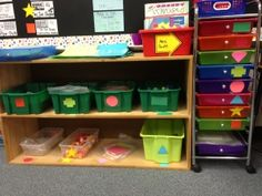 Classroom shelf with bins filled with math manipulatives