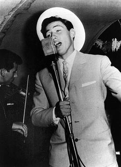 1960s: A young Silvio Berlusconi singing on a cruise ship via http://www.guardian.co.uk/