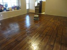 -Love everything about this stained cement floor!  It looks just like wood!  www.loraine-breakfastfordinner.blogspot.com